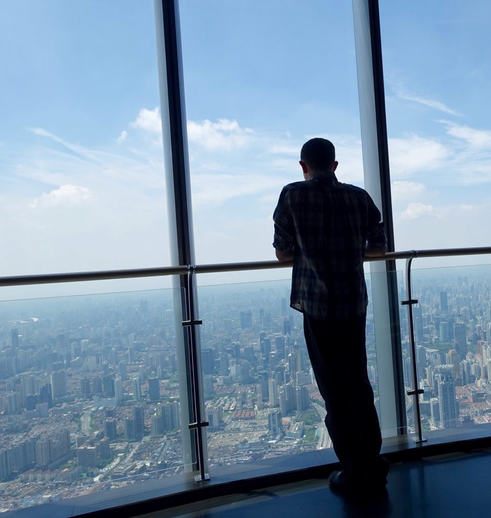 Picture of author silhouetted against the city up the Shanghai tower