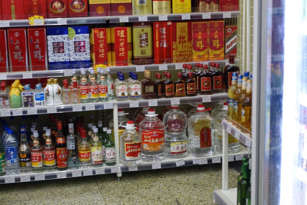 Picture of alcahol section of a chinese grocery store