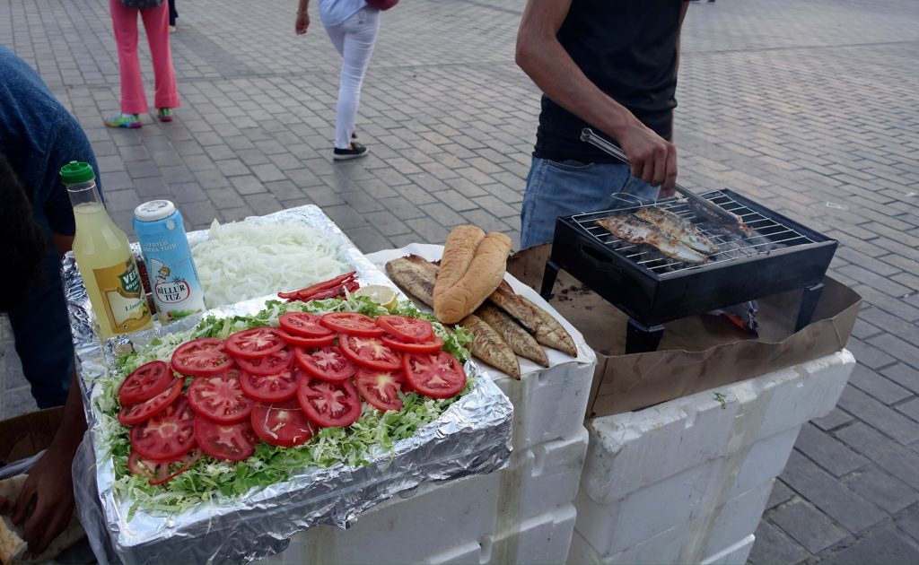 Street food stall selling fish sandwiches