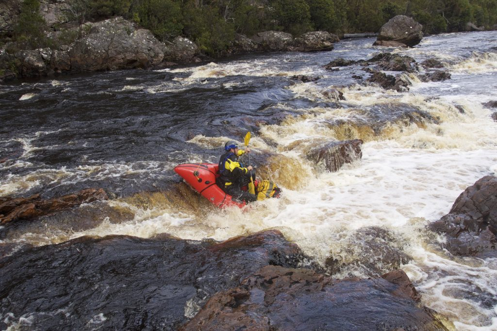 Picture of packraft running a rapid
