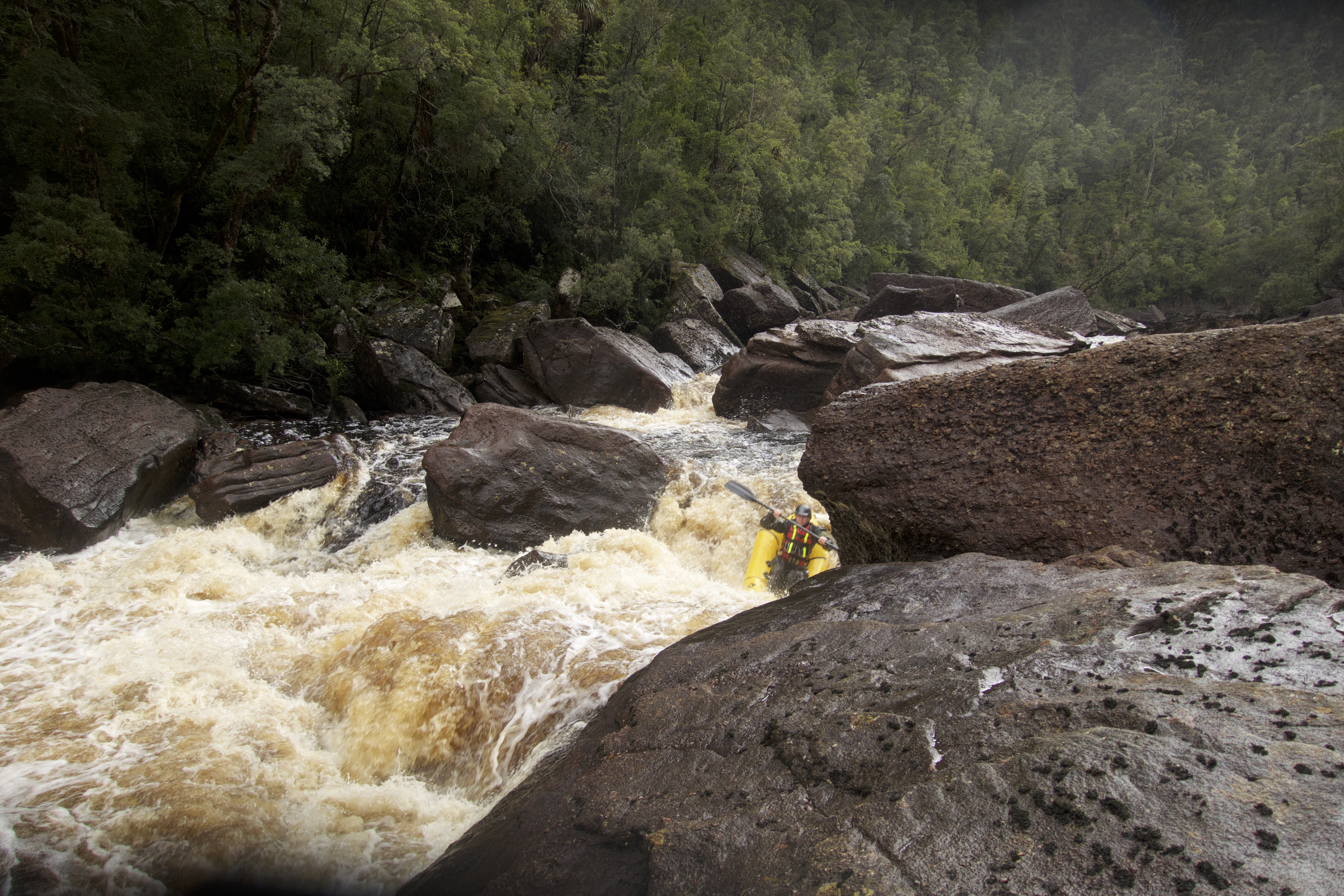 Picture of packraft nose diving in to a large rapid
