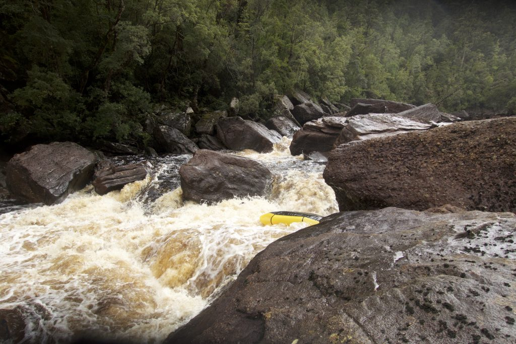 Picture of upturned packraft in the river