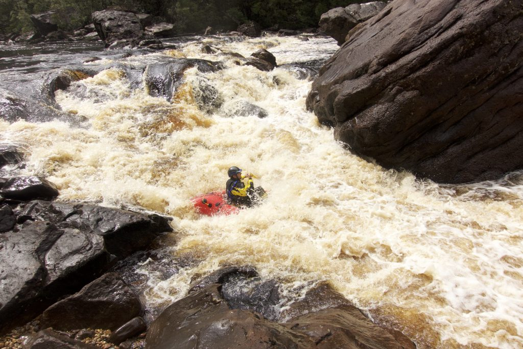 Packraft in rapid