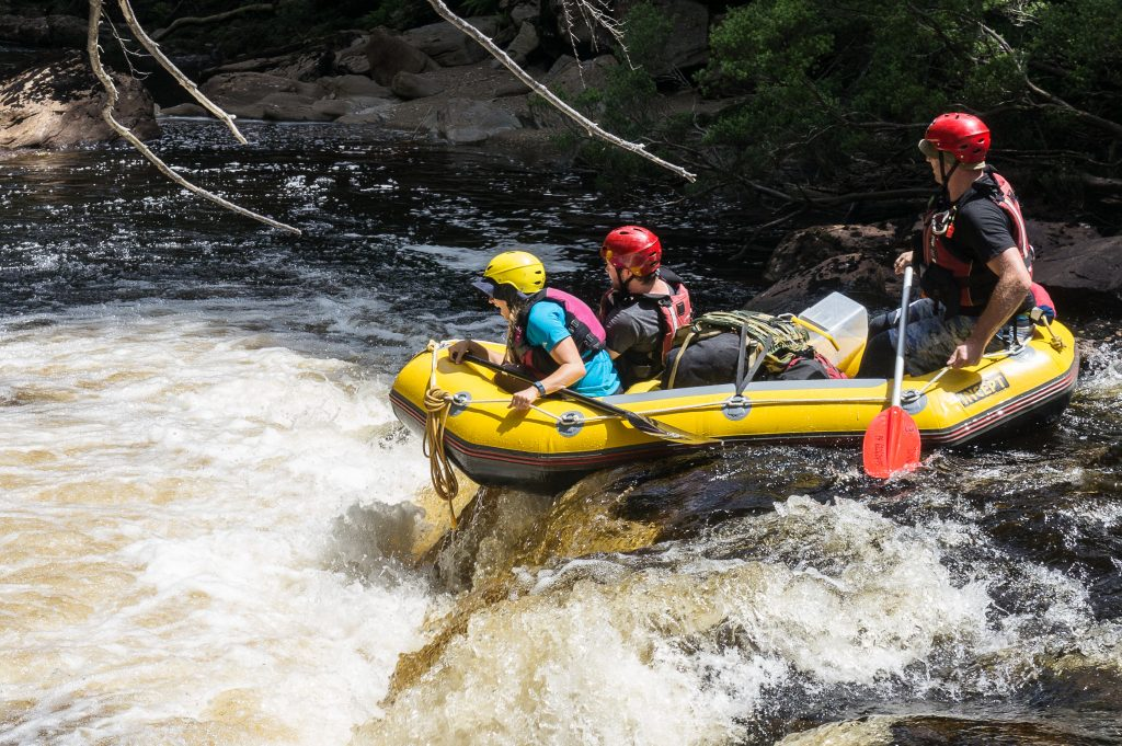 Raft going through whitewater rapids.