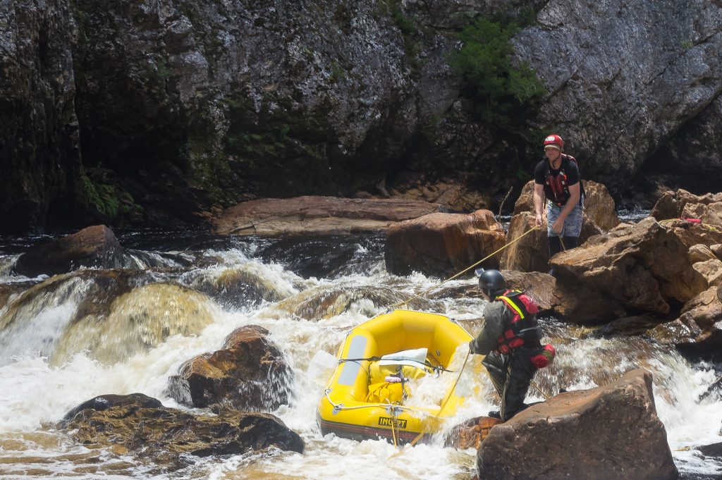 Lining the rafts down a section of the river