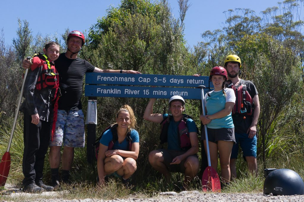The group at the end of the trip, posing near the Frenchmans Cap, Franklin River sign.